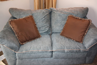 Making an Uglyish Sofa Look Better with $2 PILLOWS