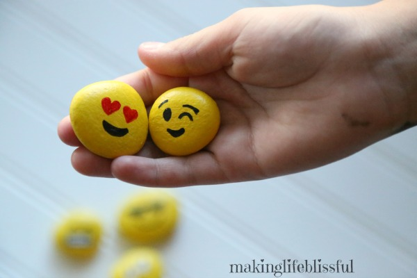 Using emoji painted rocks to teach kids about emotions
